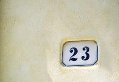 Domowa liczba dwadzieścia trzy & x28; 23& x29; na ścianie w Pienza, Tuscany Obrazy Royalty Free