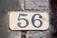 Domowej liczby 56 malujący znak na ścianie zdjęcia stock