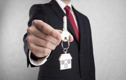 Domowy klucz w biznesmen ręce Zdjęcie Royalty Free