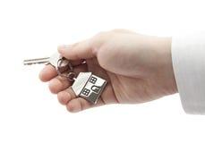 Domowy klucz w ręce odizolowywającej na biel Obraz Royalty Free