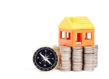 Domowy model na stercie monety Fotografia Stock