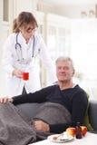 Domowy opiekun i starszy mężczyzna Fotografia Royalty Free