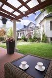 Domowy patio z rattan stołem Zdjęcie Royalty Free
