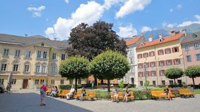 Domplatz located in the historic center with gardens and colorful house facades, and people relaxing on a sunny day Stock Images