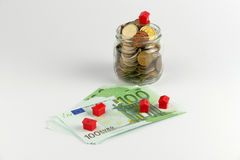 Domu i monet sterta, realestate pojęcie Zdjęcia Royalty Free