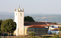 Domus Municipalis and white church, Braganca Royalty Free Stock Images