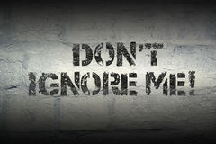Don't ignore me. Do not ignore me phrase stencil print on the grunge white brick wall Royalty Free Stock Photography