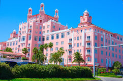 Don Cesar Resort in Saint Pete Beach Florida. Saint Petersburg Beach, FL, USA - April 23, 2016: The Don Cesar Resort with palm trees on a cloudless sunny morning Stock Photos