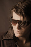 Don juan 2. Young male model with long hair  pimped out in a zoot suit with sun glasses in sepia Royalty Free Stock Images