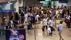 Don Meung Airport, tourist crowded at luggage picking belt. Busy airport during holiday season. Bangkok, Thailand: July 2015: Don Meung Airport, tourist crowded stock footage