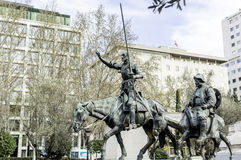 Don Quixote with his deputy Sancho. Don Quixote with his deputy visiting Madrid in the morning Stock Photos