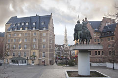 Don Quixote & Sancho Pansa statue. In Brussels city center with City Hall in distance Stock Images
