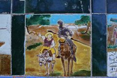 Don Quixote and Sancho Panza. Drawing on tiles of Don Quixote and Sancho Panza in a lost corner of the Maria Luisa park in Seville Royalty Free Stock Photography