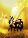 Don Quixote, Sancho Panza and the Windmills. On castilian fields, under the hot sun, Don Quixote and Sancho Panza contemplate the windmills, instants before Don Royalty Free Stock Photos