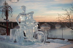 Don Quixote and it squire on a bicycle, a sculptur. E from ice  on quay of Yenisei in the city of Krasnoyarsk, Siberia, Russia Royalty Free Stock Image