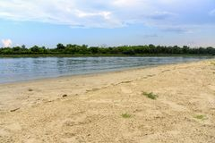Don river with golden sand shore. Beach landscape near Rostov on stock photos