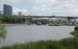 On the Don River sailing freighter. On the waterfront walk peop Stock Image