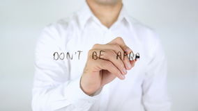 Don't Be Afraid To Be Different, Man Writing on Glass. 4k stock footage