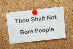 Don't Be Boring. The commandment Thou Shalt Not Bore People typed on a paper note and pinned to a cork notice board stock photo
