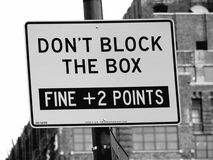 Don't Block The Box Street Sign in Manhattan, New York City. Fine plus 2 points if you're caught blocking the box stock photo