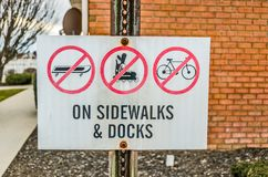 Leave Your Fun Wheels Home. Don`t bring your skateboards, roller blades, or bicycles to the sidewalks and docks Royalty Free Stock Photos