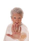 Don't come close senior woman. Stock Photography