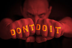 DON`T DO IT written on an angry man's fists Royalty Free Stock Photos