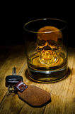 Don't Drink and Drive. A glass of whiskey with ice skull and car keys stock image