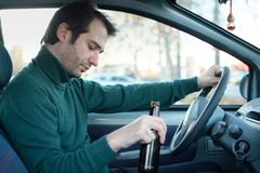 Don`t drink and drive campaign.Drunk and driving a car with a bo Stock Photography