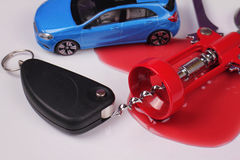 Don't drink and drive concept. Car keys, opener for wine bottles an stain red of wine. Responsibly and safety driving Stock Image