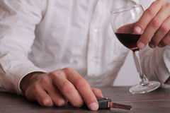 Don't drink and drive concept. Close up of man hand drinking win Royalty Free Stock Photo