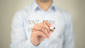 Don't Drink And Drive , man writing on transparent screen. High quality Stock Image