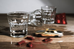 Don't drink and drive metaphor - mini car crash on a table. Stock Image