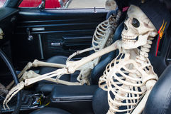 Don't drink and drive. Two skeletons sit in the front seat of a car as a message of the dangers posed by people who drink and drive Stock Photos