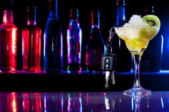Don't drive after drink - car keys and cocktail Royalty Free Stock Photography