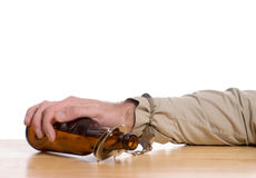 Don't Drive Drunk. A mans hand is handcuffed to a bottle of beer,  with white copyspace above Royalty Free Stock Images