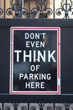 Don't Even Think of Parking Here. A No Parking sign with New York attitude: Don't Even Think of Parking Here stock photo