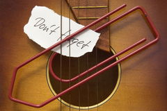 Don't forget. Note and a paperclip on a guitar Stock Photography