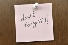 Don't forget. Post it note with don't forget! phrase Royalty Free Stock Image