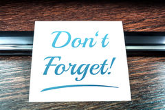 Don't Forget Reminder On Paper Lying On Wooden Table Royalty Free Stock Photos