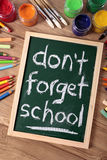 Don't forget school, back to school concept, desk, blackboard, vertical. The words Don't Forget School written on a small elementary blackboard with various Stock Images