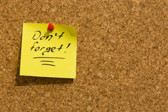 Don't forget sticky note. Pinned to a noticeboard royalty free stock photography