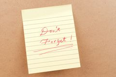 Don't forget words. Written on a sticky note Stock Photos