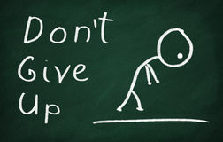 Don't give up. On the blackboard draw character and write Don't give up Royalty Free Stock Image
