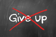 Don't give up concept. Written on school blackboard Stock Photos
