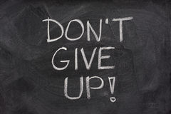 Don't give up phrase on blackboard Royalty Free Stock Image