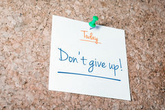 Don't Give Up Reminder For Today On Paper Pinned On Cork Board Royalty Free Stock Images