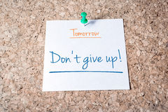 Don't Give Up Reminder For Tomorrow On Paper Pinned On Cork Board Stock Photography