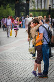 Don`t go now. Young couple Kiss in the streets of Moscow Stock Image