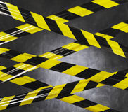 Don't Go There!. Black and yellow plastic barrier tape blocking the way royalty free stock photography